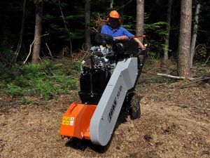 Stump grinder with integrated swivel system